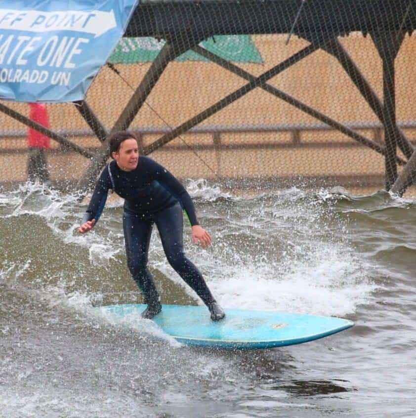 A photo of Anna from Feed Your Passion surfing
