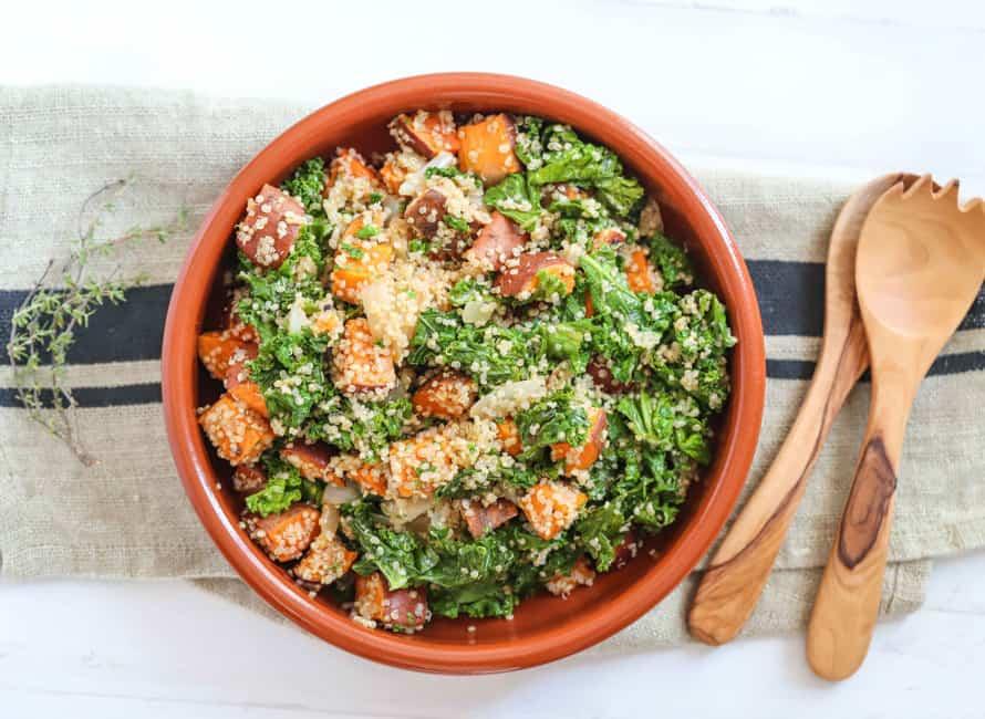 Photo of a bowl of roast sweet potato, kale and quinoa salad