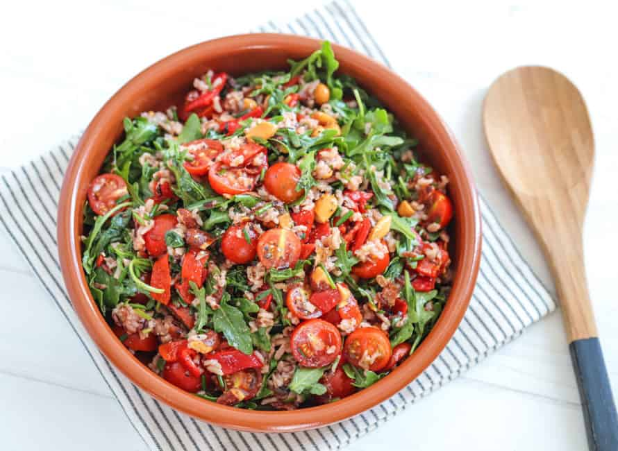 Photo of a bowl of wild rice, tomato and rocket balsamic salad