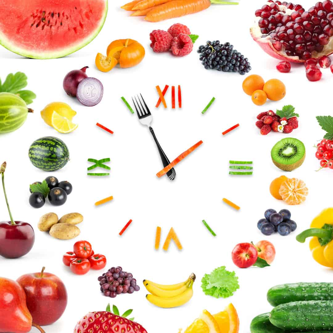 a clock made of fruit and vegetables